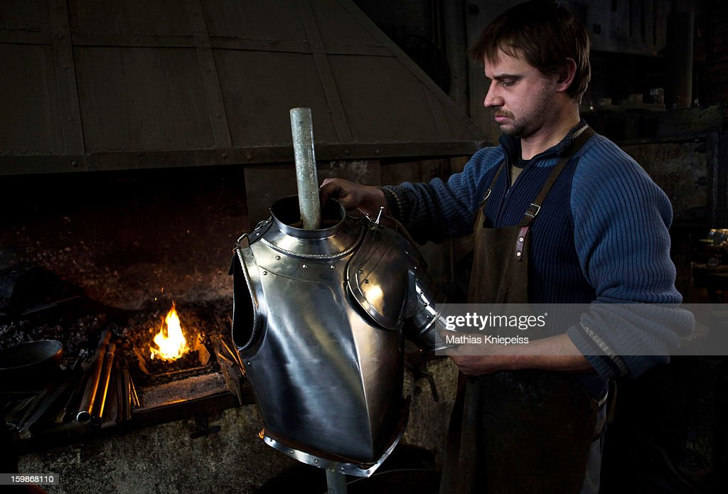 Blacksmith Georg Schmidberger of the Schmiede Schmidberger blacksmiths crafts a piece of metal that will become part of a new suit of armour for the Vatican Swiss Guard on January 21, 2013 in Molln, Austria. The Vatican has contracted Schmiede Schmidberger to manufacture 80 new sets of armour in a project that will take 7 years to complete. Most of the existing armour worn by the Swiss Guard dates back at least 100 years, when people were generally smaller than they are today, hence the existing armour does not fit today's bulkier guards. Schmiede Schmidberger is a family-run operation that has been in existence since the year 1350.