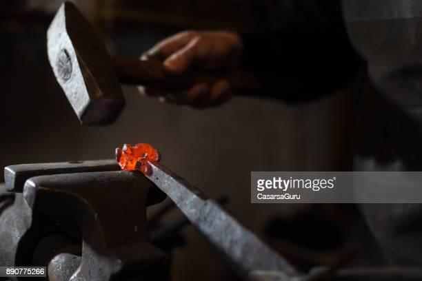 Blacksmith Hitting Molten Iron with a Hammer