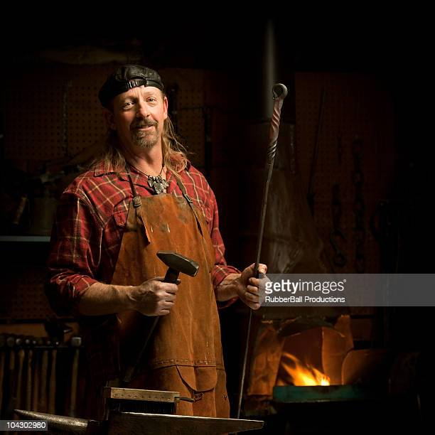 blacksmith holding a hammer