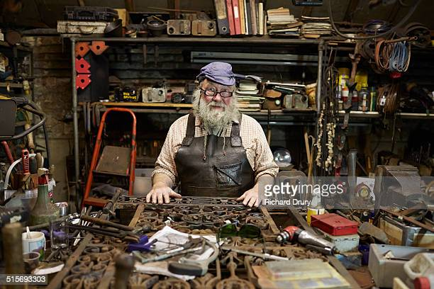 Blacksmith in his forge with metal gate