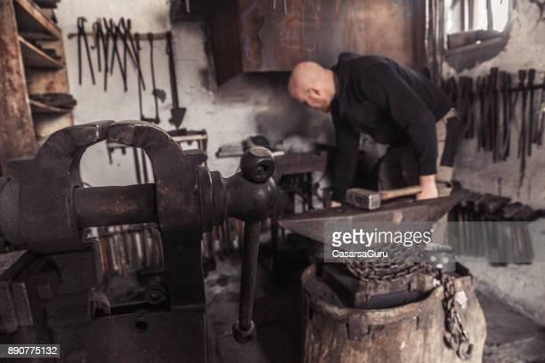 Blacksmith in his Workshop, Focus on Bench Vise