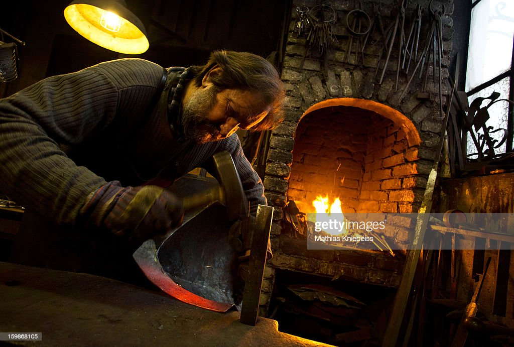 Blacksmith Johann Schmidberger Sen. of the Schmiede Schmidberger blacksmiths crafts a piece of metal that will become part of a new suit of armour for the Vatican Swiss Guard on January 21, 2013 in Molln, Austria. The Vatican has contracted Schmiede Schmidberger to manufacture 80 new sets of armour in a project that will take 7 years to complete. Most of the existing armour worn by the Swiss Guard dates back at least 100 years, when people were generally smaller than they are today, hence the existing armour does not fit today's bulkier guards. Schmiede Schmidberger is a family-run operation that has been in existence since the year 1350.
