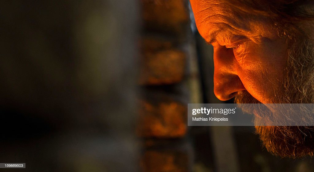Blacksmith Johann Schmidberger Sen. of the Schmiede Schmidberger blacksmiths watches the fire on January 21, 2013 in Molln, Austria. The Vatican has contracted Schmiede Schmidberger to manufacture 80 new sets of armour in a project that will take 7 years to complete. Most of the existing armour worn by the Swiss Guard dates back at least 100 years, when people were generally smaller than they are today, hence the existing armour does not fit today's bulkier guards. Schmiede Schmidberger is a family-run operation that has been in existence since the year 1350.
