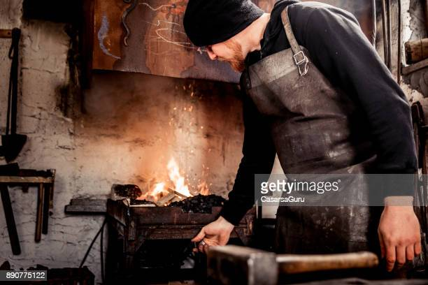 Blacksmith Preparing the Forge for Knife Manufacturing Process