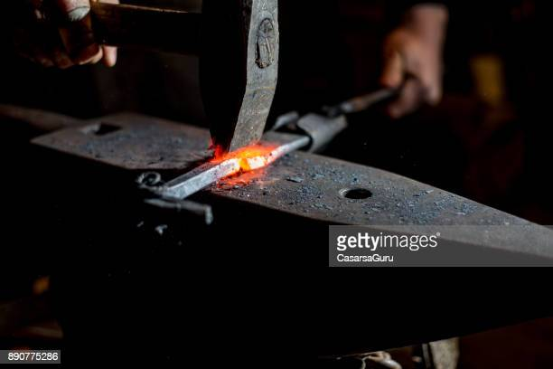 Blacksmith Shaping Knife Handle with a Hammer
