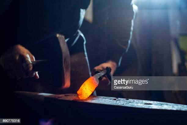 Blacksmith Shaping Knife Iron on Anvil