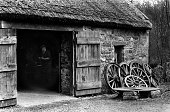 A blacksmith works in his thatchroofed shop at the recreated 19th century village at the Bunratty Folk Park near Shannon Town Ireland