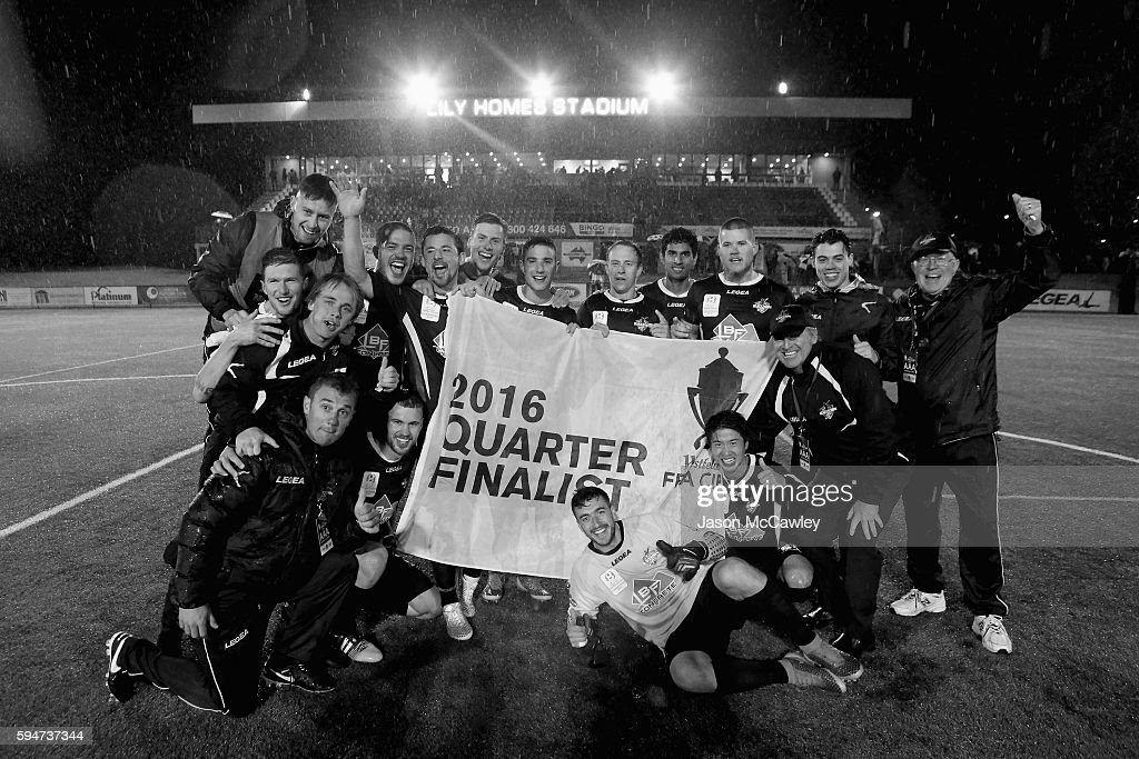 Blacktown players hold the quarter finalist banner after winning the round 16 FFA Cup match between Blacktown City and Bonnyrigg White Eagles at...