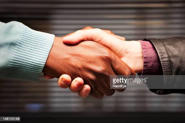 Black-white handshake