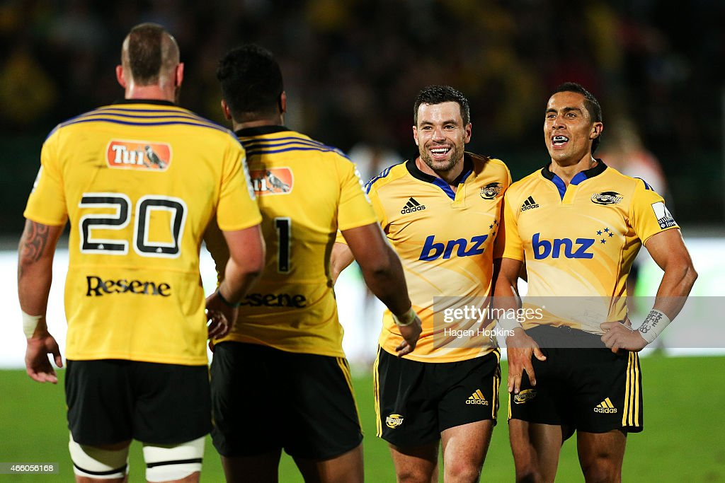 Blade Thomson Julian Savea James Marshall and Chris Smylie of the Hurricanes celebrate the win during the round five Super Rugby match between the...