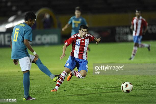 Bladimiro Ojeda from Paraguay vies for the ball with Emerson from Brazil during their Copa Sudamericana U17 football match at the Atahualpa Stadium...