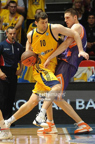 Blagota Sekulic #10 of Alba Berlin competes with Kosta Perovic #7 of Power Electronics Valencia during the Alba Berlin vs Power Electronics Valencia...