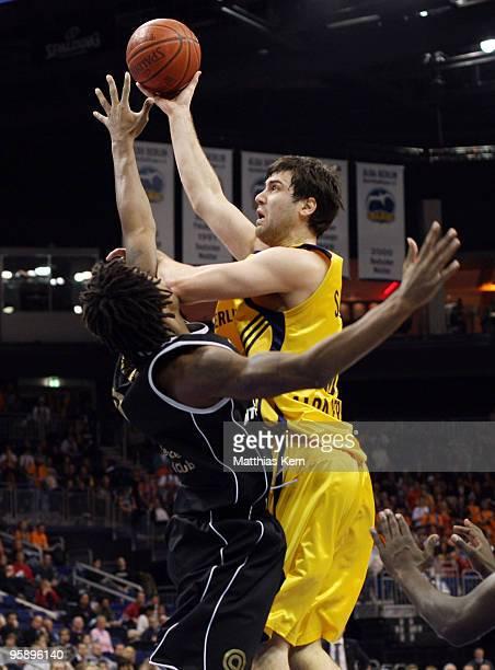 Blagota Sekulic of Berlin battles for the ball with Johnnie Gilbert of Mitteldeutscher BC during the Beko Basketball Bundesliga match between Alba...