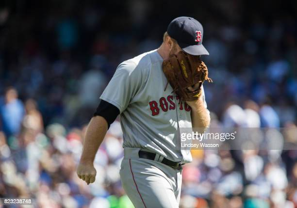 Blaine Boyer of the Boston Red Sox shouts into his glove after being taken out of the game for walking Guillermo Heredia of the Seattle Mariners in...