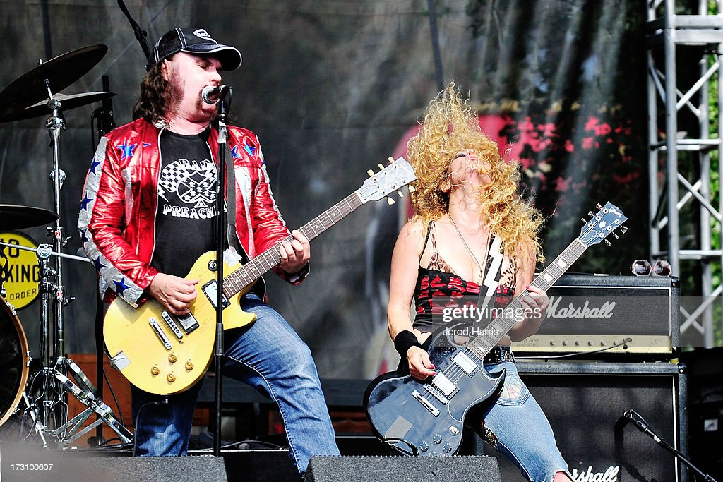 Blaine Cartwright and wife Ruyter Suys of Nashville Pussy perform at The Hootenanny music festival on July 6, 2013 in Orange, California.