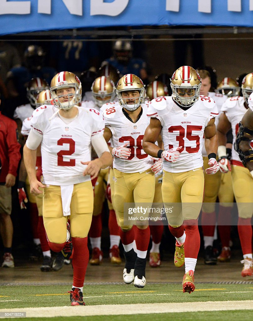 Blaine Gabbert #2, Jarryd Hayne #38 and Eric Reid #35 of the San Francisco 49ers run onto the field prior to the game against the Detroit Lions at Ford Field on December 27, 2015 in Detroit, Michigan. The Lions defeated the 49ers 32-17.