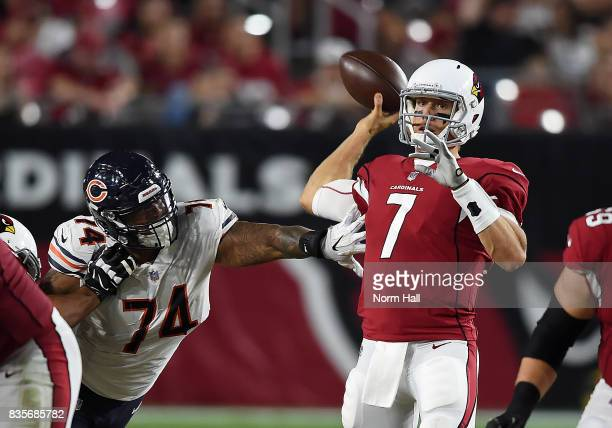 Blaine Gabbert of the Arizona Cardinals has his throwing arm hit by Roy RobertsonHarris of the Chicago Bears while attempting a pass during the...