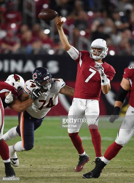 Blaine Gabbert of the Arizona Cardinals has the ball knocked out of his hand by Roy RobertsonHarris of the Chicago Bears while attempting a pass...
