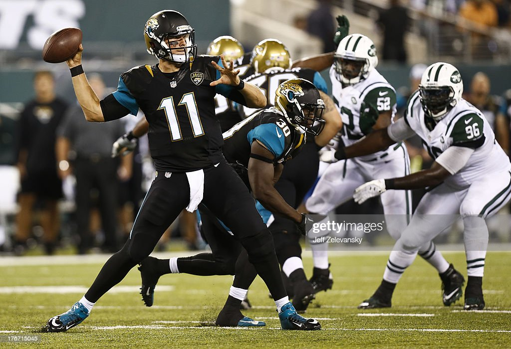 Blaine Gabbert #11 of the Jacksonville Jaguars passes against the New York Jets during their preseason game at MetLife Stadium on August 17, 2013 in East Rutherford, New Jersey.