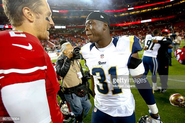 Blaine Gabbert of the San Francisco 49ers and Maurice Alexander of the Los Angeles Rams talk on the field following the game at Levi Stadium on...