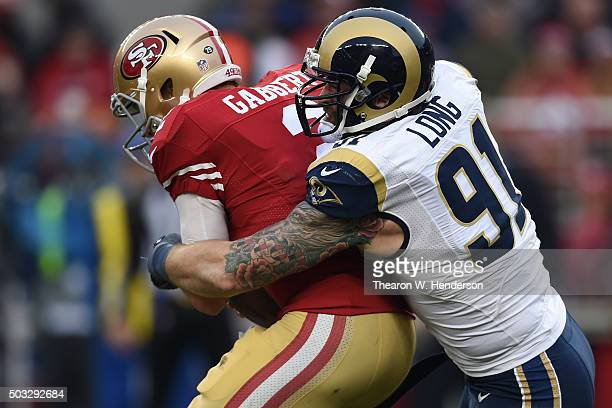 Blaine Gabbert of the San Francisco 49ers is sacked by Chris Long of the St Louis Rams during their NFL game at Levi's Stadium on January 3 2016 in...
