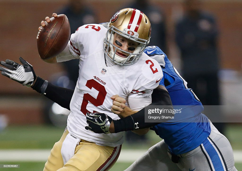 Blaine Gabbert #2 of the San Francisco 49ers is sacked by Devin Taylor #98 of the Detroit Lions in the third quarter at Ford Field on December 27, 2015 in Detroit, Michigan. The Detroit Lions win 32-17 over the San Francisco 49ers.