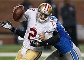 Blaine Gabbert of the San Francisco 49ers is sacked by Devin Taylor of the Detroit Lions in the third quarter at Ford Field on December 27 2015 in...