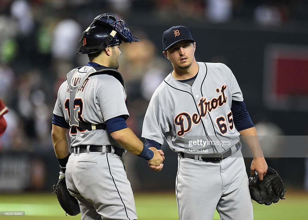 Blaine Hardy #65 and <a gi-track='captionPersonalityLinkClicked' href=/galleries/search?phrase=Alex+Avila&family=editorial&specificpeople=5749211 ng-click='$event.stopPropagation()'>Alex Avila</a> #13 of the Detroit Tigers celebrate an 11-5 win against the Arizona Diamondbacks at Chase Field on July 23, 2014 in Phoenix, Arizona.