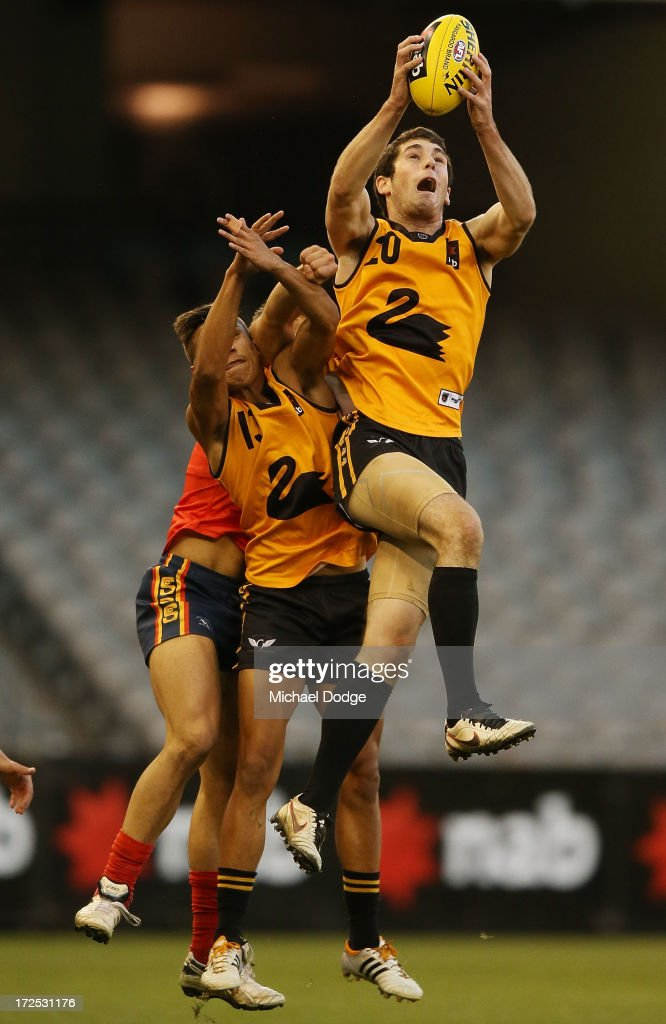 Blaine Johnson of Western Australia marks the ball during the AFL Under 18s Championship match between South Australia and Western Australia at Etihad Stadium on July 3, 2013 in Melbourne, Australia.