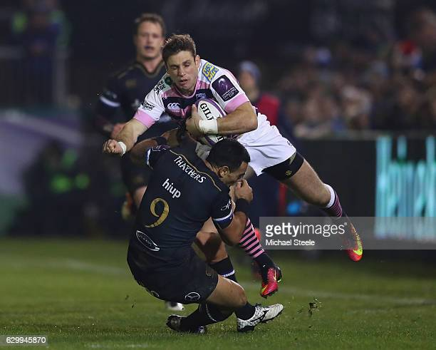 Blaine Scully of Cardiff is tackled by Kahn Fotuali'i of Bath during the European Rugby Challenge Cup match between Bath Rugby and Cardiff Blues at...