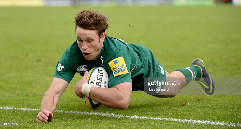 Blaine Scully of Leicester Tigers dives over for a try during the Aviva Premiership match between Leicester Tigers and Saracens at Welford Road on May 10, 2014 in Leicester, England.