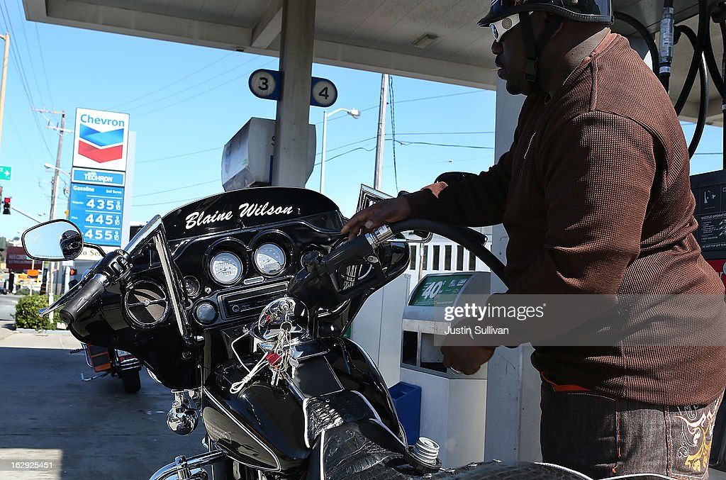 <a gi-track='captionPersonalityLinkClicked' href=/galleries/search?phrase=Blaine+Wilson&family=editorial&specificpeople=162692 ng-click='$event.stopPropagation()'>Blaine Wilson</a> pumps gas into his motorcycle at a Chevron gas station on March 1, 2013 in San Francisco, California. The California Board of Equalization voted on Thursday to implement a statewide excise tax on gasoline starting July 1 that will increase the tax by 3.5 cents to 39.5 cents per gallon.