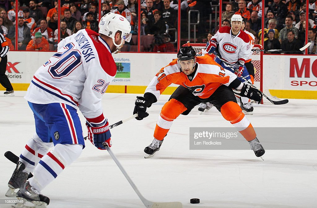 Blair Betts of the Philadelphia Flyers defends against an attempted shot by James Wisniewski of the Montreal Canadiens on January 25 2011 at the...