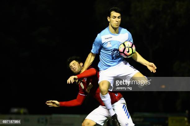 Blair Brown of the Sharks and Chris Payne of United 58 contest for the ball during the NSW NPL Men's match between Sutherland Sharks FC and Sydney...