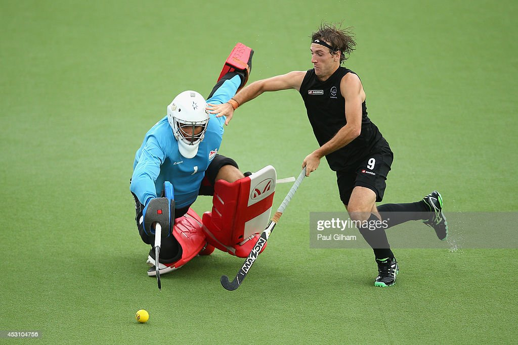Blair Hilton of New Zealand takes a penalty against Goalkeeper George Pinner of England during a penalty shoot out in the bronze medal match between New Zealand and England at Glasgow National Hockey Centre during day eleven of the Glasgow 2014 Commonwealth Games on August 3, 2014 in Glasgow, United Kingdom.