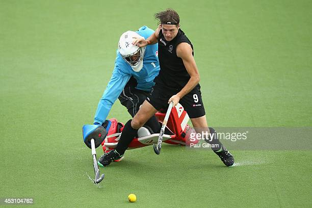 Blair Hilton of New Zealand takes a penalty against Goalkeeper George Pinner of England during a penalty shoot out in the bronze medal match between...