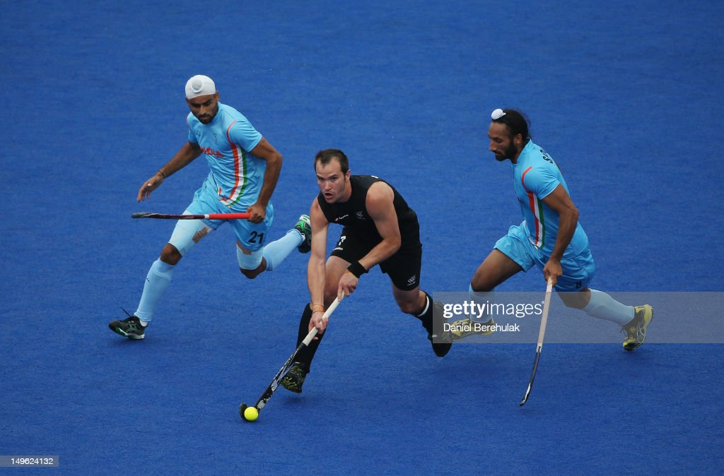 Blair Hopping of New Zealand is challenged by Gurwinder Singh Chandi and Sardar Singh of India during the Men's preliminary Hockey match on Day 5 of the London 2012 Olympic Games at Riverbank Arena on August 1, 2012 in London, England.