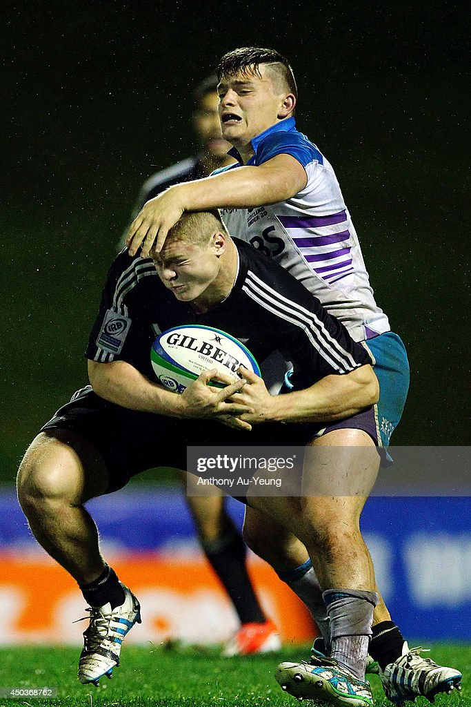 Blair Hutchison of Scotland makes a tackle on James O'Reilly of New Zealand during the 2014 Junior World Championship match between New Zealand and Scotland at ECOLight Stadium, Pukekohe on June 10, 2014 in Auckland, New Zealand.