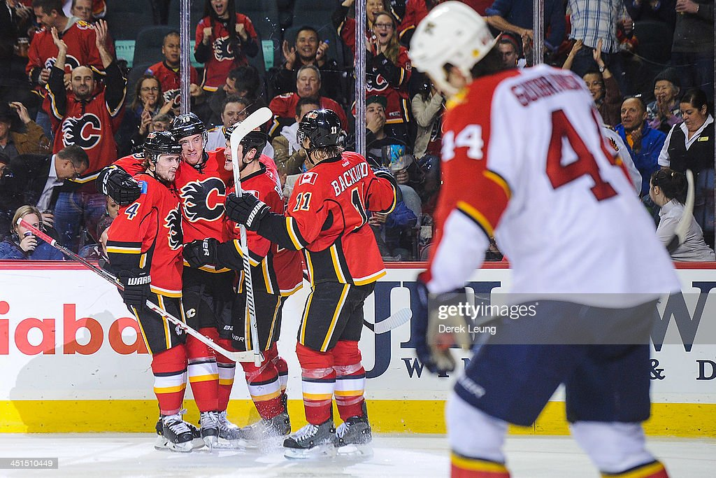 Blair Jones #19 of the Calgary Flames celebrates scoring his team's third goal against the Florida Panthers along with his teammates Kris Russell #4, Lance Bouma #17, and Mikael Backlund #11 during an NHL game at Scotiabank Saddledome on November 22, 2013 in Calgary, Alberta, Canada. The Flames defeated the Panthers 4-3 in shootout.