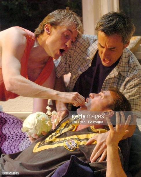 Blair McDonough is fed cheese by Andrew Robb and Tom Sangster as they perform a scene from The Vegemite Tales at The Venue Leicester Square central...
