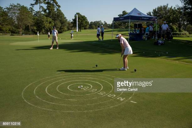 Blair McKenzie putts during a regional round of the Drive Chip and Putt Championship at The Club at Carlton Woods on October 8 2017 in The Woodlands...