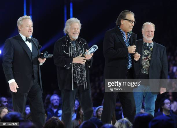 Blair Thornton Robbie Bachman Randy Bachman and Fred Turner receive their award at the 2014 Juno Awards held at the MTS Centre on March 30 2014 in...