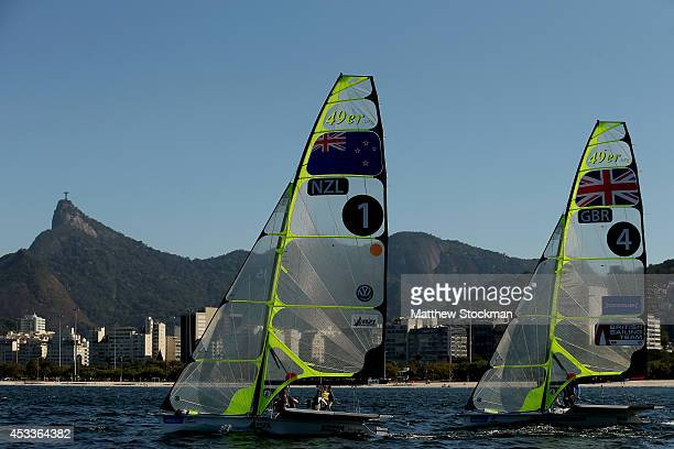 Blair Tuke and Peter Burling of New Zealand Dylan Fletcher and Alain Sign of Great Britain sail on the Pão de Açúcar course during the Mens 49er...