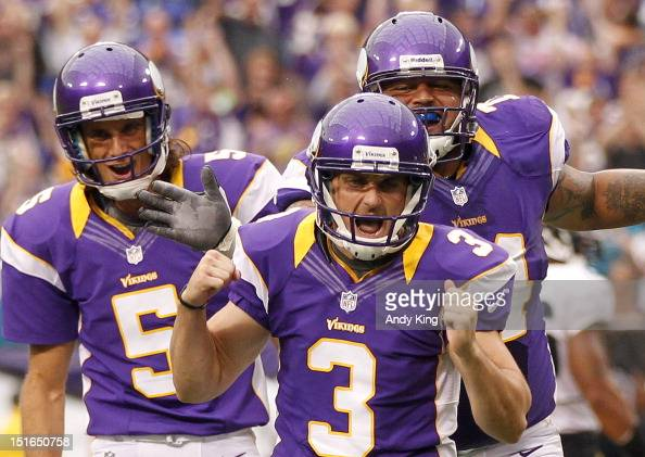 Blair Walsh of the Minnesota Vikings celebrates the game tying field goal with holder Chris Kluwe and lineman Charlie Johnson against the...