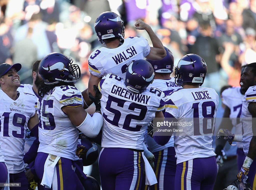 Blair Walsh of the Minnesota Vikings is lifted up by teammate Chad Greenway as the celebrate after Walsh kicked the gamewinning field goal against...