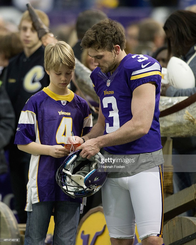 Blair Walsh #3 of the Minnesota Vikings signs an autograph for a fan before the game against the Detroit Lions on December 29, 2013 at Mall of America Field at the Hubert H. Humphrey Metrodome in Minneapolis, Minnesota.