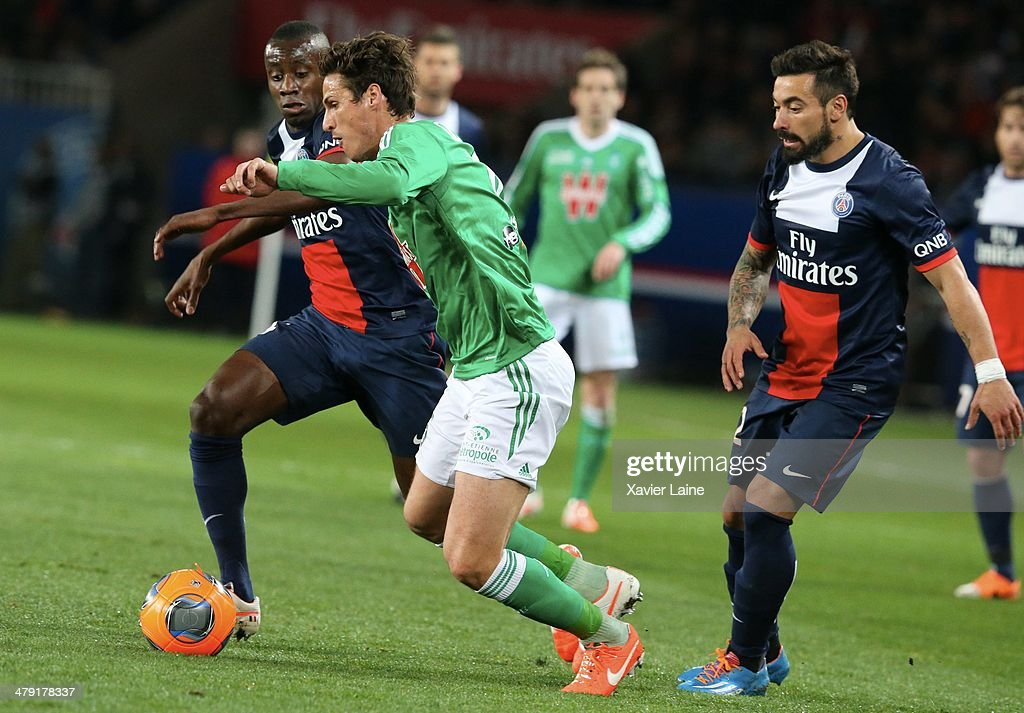 <a gi-track='captionPersonalityLinkClicked' href=/galleries/search?phrase=Blaise+Matuidi&family=editorial&specificpeople=801779 ng-click='$event.stopPropagation()'>Blaise Matuidi</a> and <a gi-track='captionPersonalityLinkClicked' href=/galleries/search?phrase=Ezequiel+Lavezzi&family=editorial&specificpeople=5451126 ng-click='$event.stopPropagation()'>Ezequiel Lavezzi</a> of Paris Saint-Germain and Jeremy Clement of AS Saint-Etienne during the French Ligue 1 match between Paris Saint-Germain FC and AS Saint-Etienne at Parc Des Princes on March 16, 2014 in Paris, France.