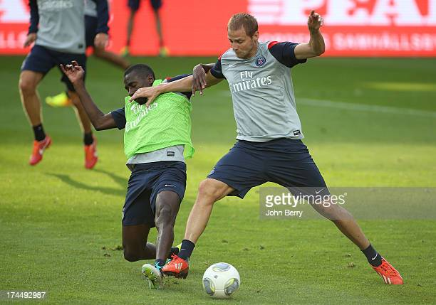 Blaise Matuidi and Mathieu Bodmer of PSG in action during a training session on the eve of the friendly match between Paris SaintGermain and Real...