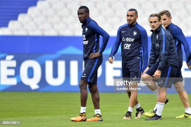 Blaise Matuidi Dimitri Payet Antoine Griezmann and Lucas Digne of France warm up before a France training session ahead of the France v Belarus FIFA...