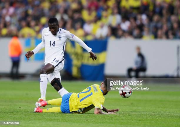 Blaise Matuidi of France and Jimmy Durmaz of Sweden competes for the ballduring the FIFA 2018 World Cup Qualifier between Sweden and France at...